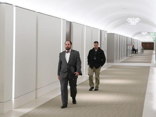 Legislators and visitors travel a new 452 ft tunnel