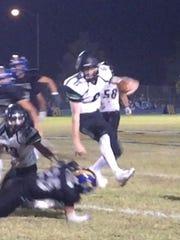 Cade Anderson hurdles a Pirate defender in a 26-14