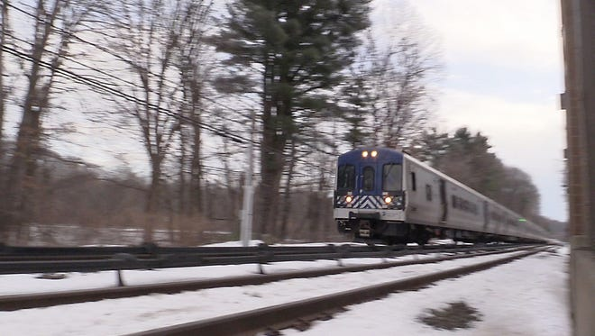 A Metro-North commuter train passes through the Commerce St. crossing in Valhalla on Friday, Jan. 29, 2016.