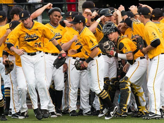 The Iowa Hawkeyes take to the field during a baseball game at Duane Banks Field in Iowa City between Iowa and Penn State on Saturday, May 19, 2018.