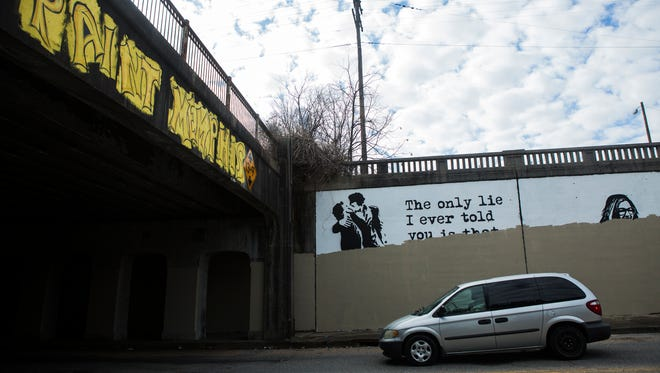 February 9, 2018 - A vehicle travels through an underpass near the intersection of Willett and Lamar where murals from Paint Memphis have been recently erased. Memphis this week mistakenly painted over several Midtown murals as they exorcised artwork that some City Council members claimed was 'satanic.' Instead of painting oversix controversial murals flagged by City Council members, Public Works crews painted over sevennon-controversial murals, destroying artwork valued at about $35,000 that was donated by15 artists as part of Paint Memphis' annual, 133-mural public art project, said Karen Golightly, who leads Paint Memphis.