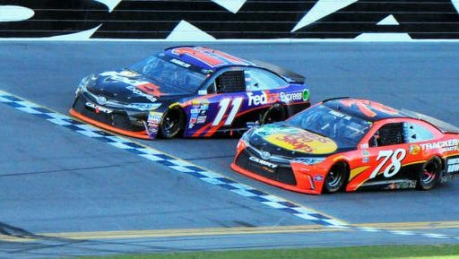 Denny Hamlin, driver of the #11 FedEx Express Toyota edges out Martin Truex Jr driver of the #78  Bass Pro Shops /Tracker Boats Toyota for the closest win in Daytona 500 history during the running of the 58th annual Daytona 500, Sunday afternoon at the Daytona International Speedway .