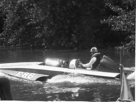 Sandy Ross, who started racing in his 20s, sits in a boat named the Perkolator sometime in the 1950s.