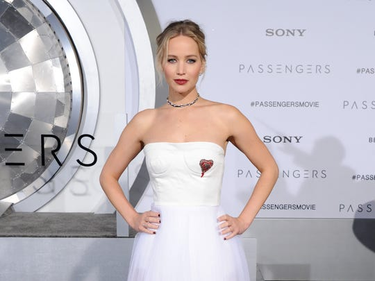 Jennifer Lawrence arrives at the premiere of Columbia