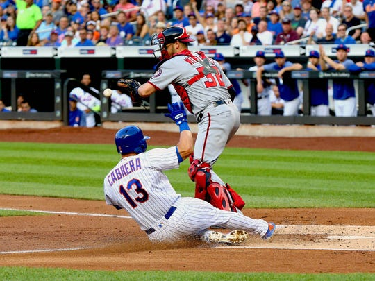 New York Mets second baseman Asdrubal Cabrera (13) scores on a sacrifice fly against the Washington Nationals during the first inning at Citi Field.