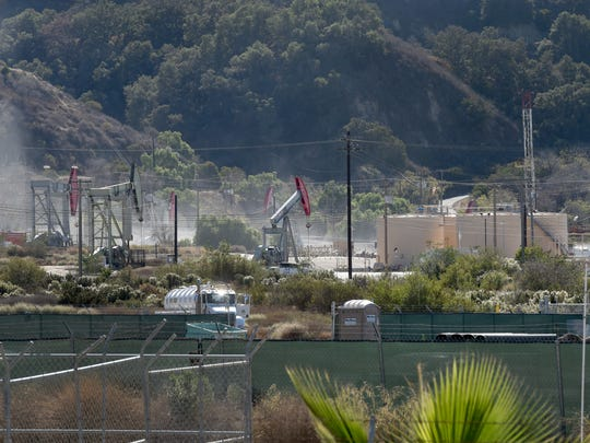 A cloud hangs above an oil production property near Ventura Avenue and Shell Road on Thursday after a pipe cracked, releasing natural gas. According to Ventura County Fire Department officials, a well was being decommissioned when the pipe broke.