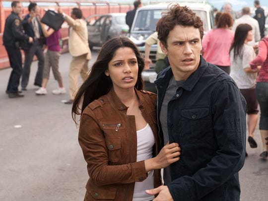"""James Franco and Freida Pinto in a scene from """"Rise of the Planet of the Apes"""" (2011)."""