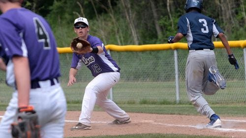 Granville Christian Academy first baseman Garrett Nauer records a putout during the 2015 Division IV district tournament game against Wellington.