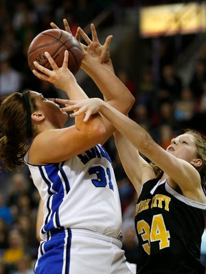 Cuba City's Kaitlyn Kaiser (right) tries to defend Saint Mary's Springs' Kelli Schrauth during the first half of Thursday's WIAA Division 4 state semifinal basketball game at the Resch Center in Ashwaubenon
