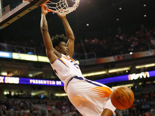 Suns rookie Josh Jackson dunks against the Thunder on Sunday.