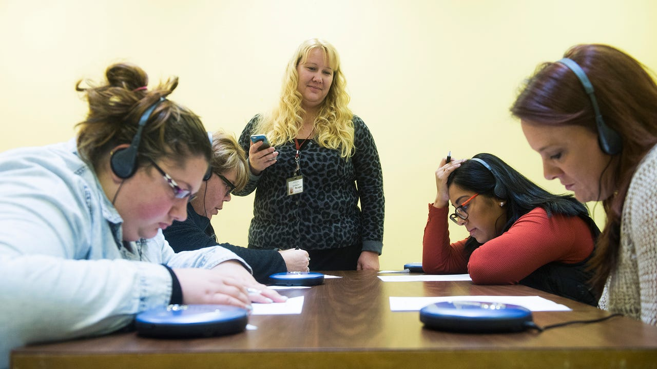 TrueNorth Wellness employees participated in a hearing simulation to better understand living with mental illness. The participants wore headphones with a continuous voice track that played.