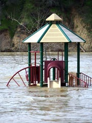 A playground is seen Feb. 13, 2017, submerged in flowing