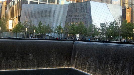The National September 11 Memorial Museum, seen from across one of the reflecting pools at the World Trade Center site.