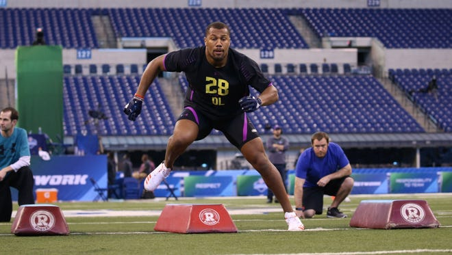 Mar 4, 2018; Indianapolis, IN, USA; North Carolina State Wolfpack defensive lineman Bradley Chubb goes through work out drills during the 2018 NFL Combine at Lucas Oil Stadium. Mandatory Credit: Brian Spurlock-USA TODAY Sports