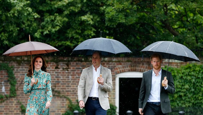 Britain's Prince William, center, his wife Kate, Duchess of Cambridge and Prince Harry arrive for an event at the memorial garden in Kensington Palace, London, Wednesday, Aug. 30, 2017.