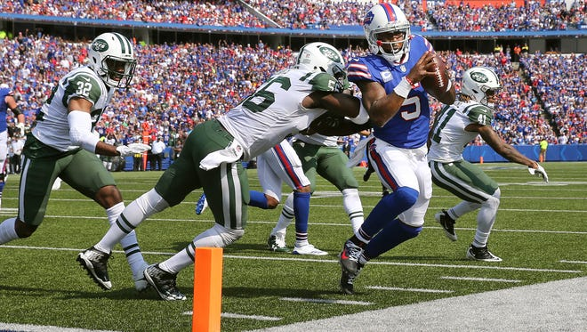 Bills quarterback Tyrod Taylor is knocked out of bounds by Jets Demario Davis but not before he gets a first down leading to a touchdown.