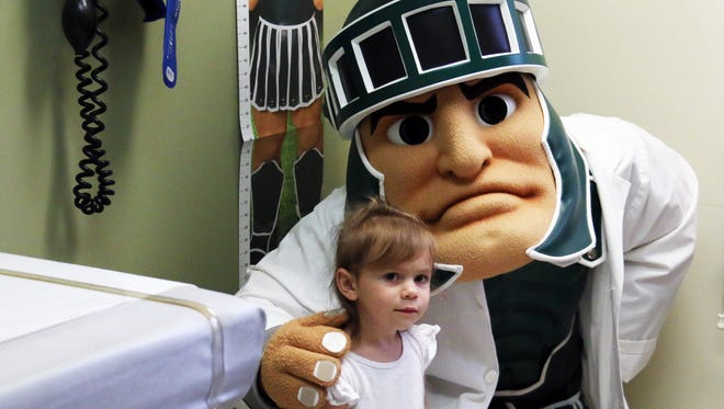 McLaren Greater Lansing has recently partnered with the MSU Alumni Association to support the Sparty Mascot Program by offering Sparty growth charts to local children.