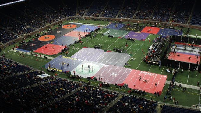 The scene during the MHSAA individual wrestling state finals at Ford Field on Friday, March 2, 2018.