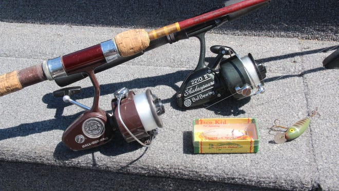 Fishing reels, rods and lures made in the 1960s and 60s rest on the console of a boat during a 2018 outing in northwestern Wisconsin.