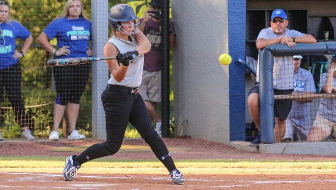 Central's Lacee Stewart (5) gets an RBI single after hitting a line drive into the leg of Escambia pitcher Julia Rodemoyer in the 10th annual Subway High School All-Star softball game at UWF on Thursday, June 8, 2017.