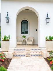 The entrance to the home features a marble and tile