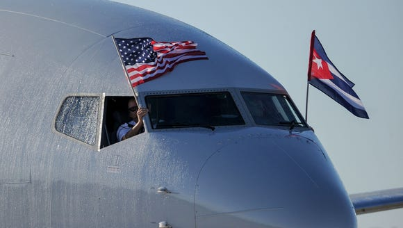 An American Airlines plane fluttering U.S. and Cuba