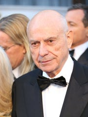 Alan Arkin (center) arrives at the 85th annual Academy