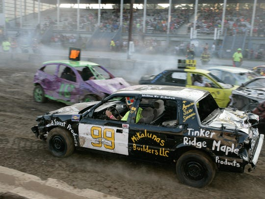 Cars collide during the 2014 Chenango County Fair Demolition Derby.