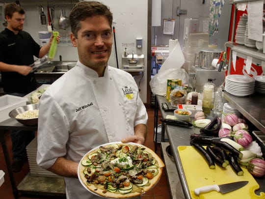 Owner-operator Jeff Mitchell and his veggie flatbread pizza at The Local, a Naples farm-to-table restaurant using locally sourced ingredients.