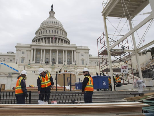 Workers build portions of the inaugural platform at