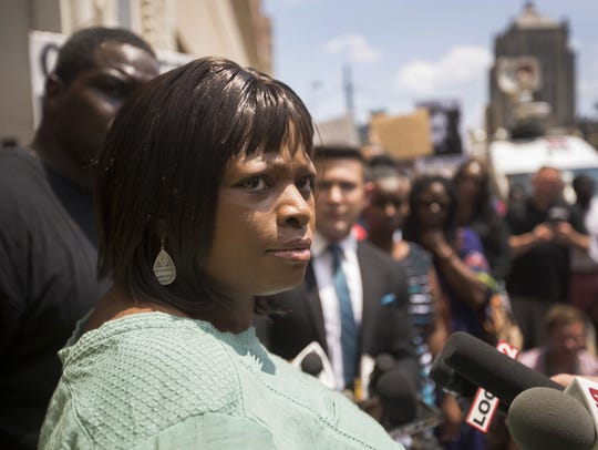 Terina Allen, sister of Sam DuBose, talks with media
