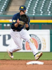 Jake Bivens (18) short stop for the Michigan Wolverines