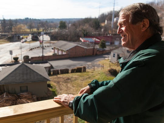 Valley Area Community Support's Clarke Banta, who has been helping to see the renovations at 240 Kalorama Street to completion, admires the view of Staunton from the top of the building's balcony on Friday, Dec. 26, 2014.
