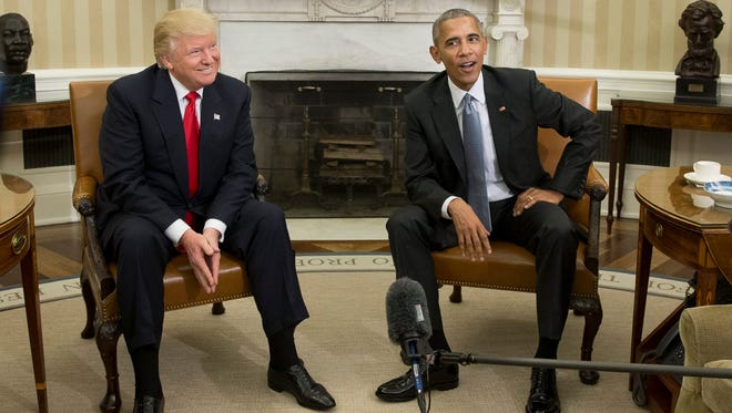 US President Barack Obama (R) and President-elect Donald Trump (L) meet in the Oval Office of the White House on Nov. 10, 2016.