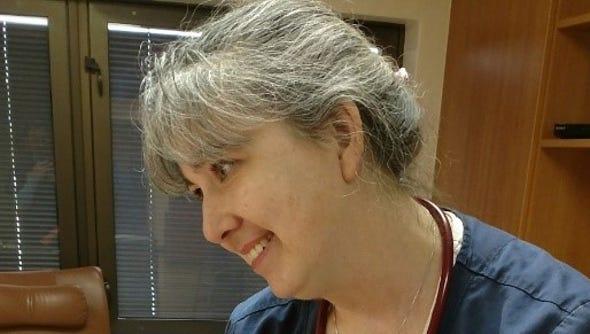 Nurse Christine Brenneman reviews a chart with one