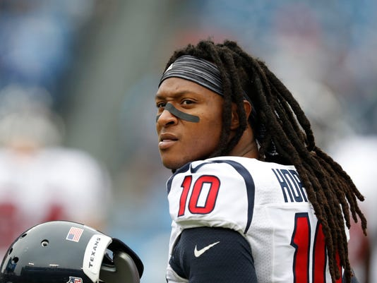 FILE - In this Jan. 1, 2017, file photo, Houston Texans wide receiver DeAndre Hopkins warms up before an NFL football game against the Tennessee Titans in Nashville, Tenn. A person familiar with the negotiations says the Texans and Hopkins have agreed to a five-year, $81 million contract extension. The person spoke to The AP on the condition of anonymity because the deal had not yet been announced by the teams. (AP Photo/Weston Kenney, File)