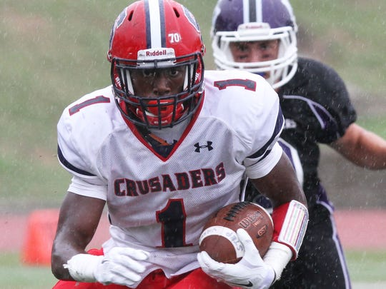 Stepinac's Gavin Heslop (1) looks for some running room in the Monroe Woodbury defense during a football game at Archbishop Stepinac High School in White Plains Sept. 13, 2014. Stepinac won the game 28-10.