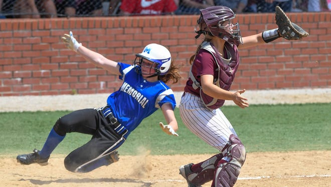 Mt. Vernon catcher Lauren Earhart waits for the ball as Memorial's Molly Jillson begins her side toward home plate to score as the Mt. Vernon Wildcats play the Memorial Tigers in the sectional final in Boonville Saturday, May 27, 2017.