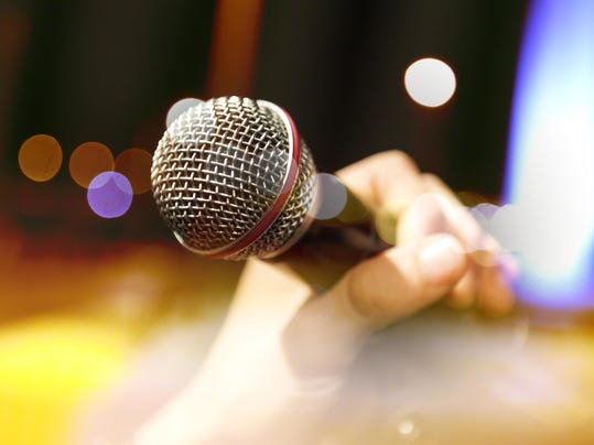 Musical background.Mic and singer
