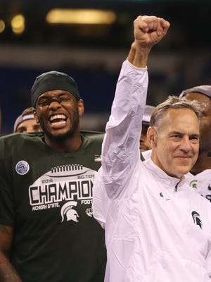 Michigan State coach Mark Dantonio celebrates after the 16-13 win against Iowa in the Big Ten Championship on Saturday at Lucas Oil Stadium.