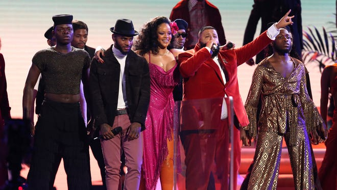 "Bryson Tiller, second from left, Rihanna, and DJ Khaled perform ""Wild Thoughts"" at the 60th annual Grammy Awards at Madison Square Garden on Sunday."