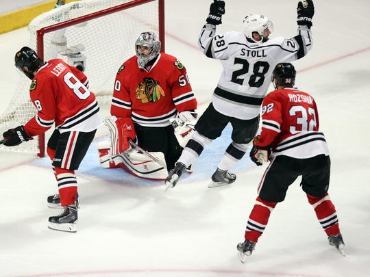 Jun 1, 2014; Chicago, IL, USA; (EDITORS NOTE: caption correction due to official scoring change) Los Angeles Kings center Jarret Stoll (28) reacts after teammate Alec Martinez (not pictured) scored the game-winning goal past Chicago Blackhawks defenseman Nick Leddy (8) , defenseman Michal Rozsival (32) and goalie Corey Crawford (50) during the overtime period in game seven of the Western Conference Final of the 2014 Stanley Cup Playoffs at United Center. Mandatory Credit: Dennis Wierzbicki-USA TODAY Sports
