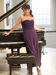 Pianist Hiroko Yamazaki wears a purple strapless silk