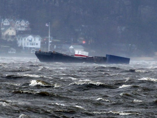One of two barges spotted floating downriver in the