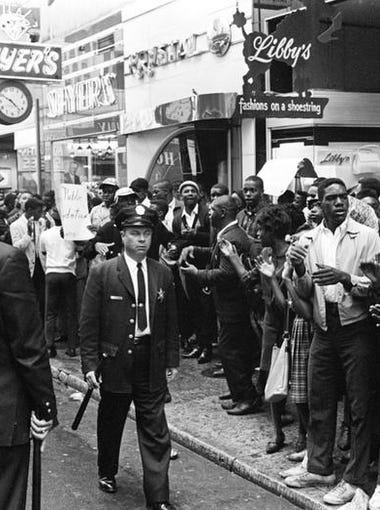 Nashville policemen line up in the streets as large group of civil right demonstrators fill up the sidewalk on downtown Church Street as they protest against both the Krystal and Tic Toc restaurants April 27, 1964. After a short demonstration there, the group marched several blocks to Morrison's on West End Ave.