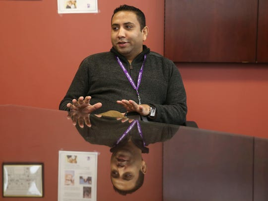 Tak Acharya, a native of Bhutan, talks about the challenges refugees face coming to the United States at Catholic Family Centers where he works in downtown Rochester Friday, Jan. 27, 2017.