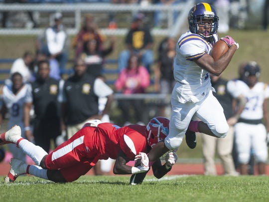 Camden's Najyere Edwards is tripped up by Pennsauken's Donte Jamison as Edwards runs the ball during the second quarter of Saturday's 40-7 road win for the Panthers.