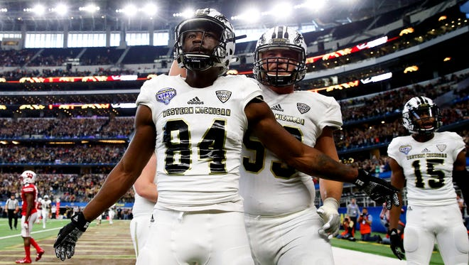 Western Michigan Broncos wide receiver Corey Davis (84) reacts after catching a touchdown pass during the second half of the 2017 Cotton Bowl against the Wisconsin Badgers at AT&T Stadium.