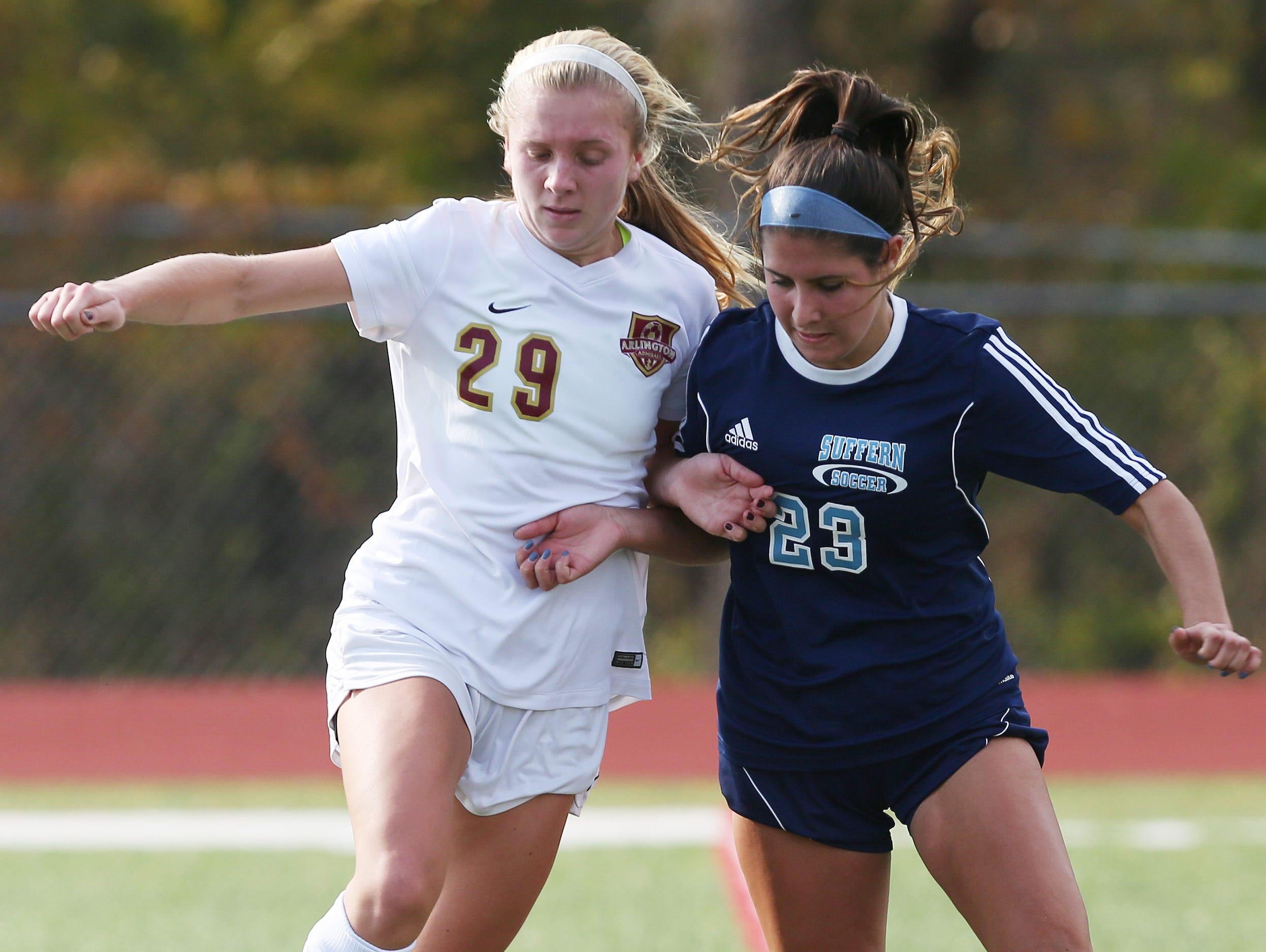 From left, Arlington's Molly Feighan and Suffern's Jackie Santangelo battle for the ball during the Section 1 Class AA championship game at Yorktown High School on Sunday.