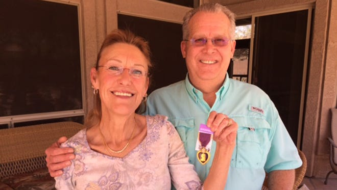 Laura and Jake Hardy purchased a Purple Heart Medal awarded to a World War II veteran at a Mesa, Ariz., Goodwill store on Saturday, March 12, 2016. Using Facebook, they were able to find the rightful owner and they plan to return it.